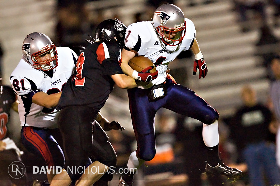 Patriot wide receiver Sean Trymbiski (1) gets some help from Tyler Zak (81) while fending off a Hatter defensiveman.