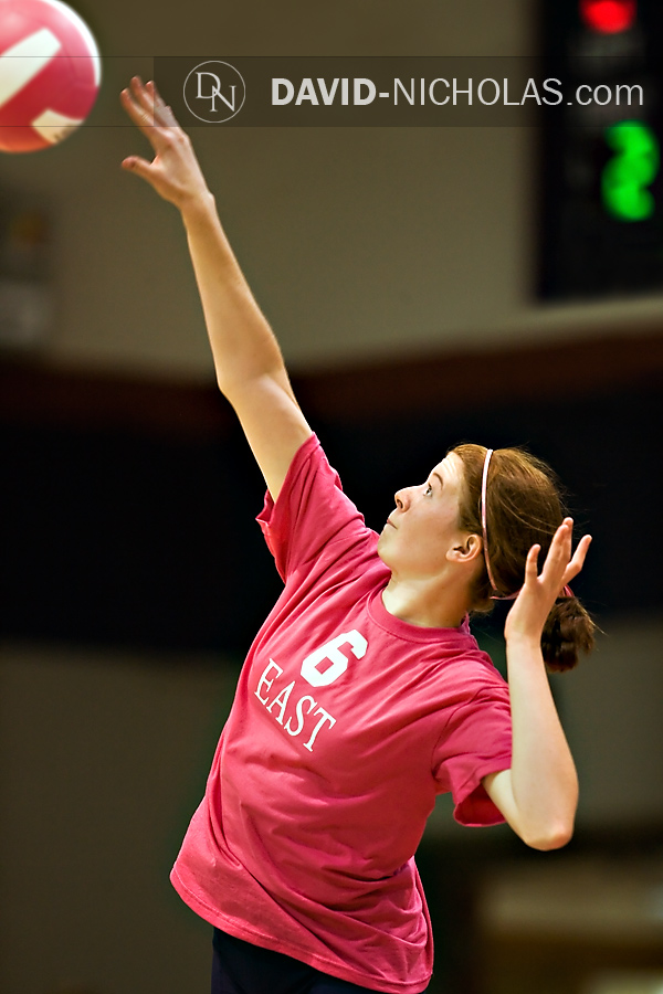 Lady Patriot Grace Patterson on serve with one of the evening's pink volleyballs.