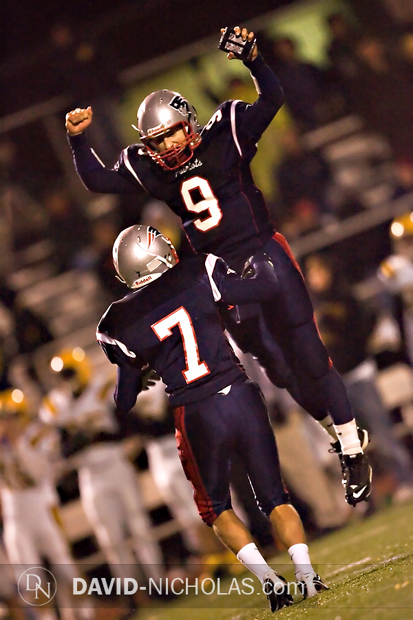 C.B. East's Sean Reilly (9) and Jay Leventhal (7) celebrate Leventhal's 40-yard clutch field goal that put the Patriots ahead of the Bucks 16-14 in the 3rd quarter.