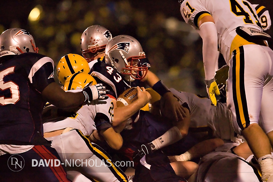 A sea of C.B. West defenders converge upon C.B. East's Jake Schwarz (43) during the last Patriot possession in the game.