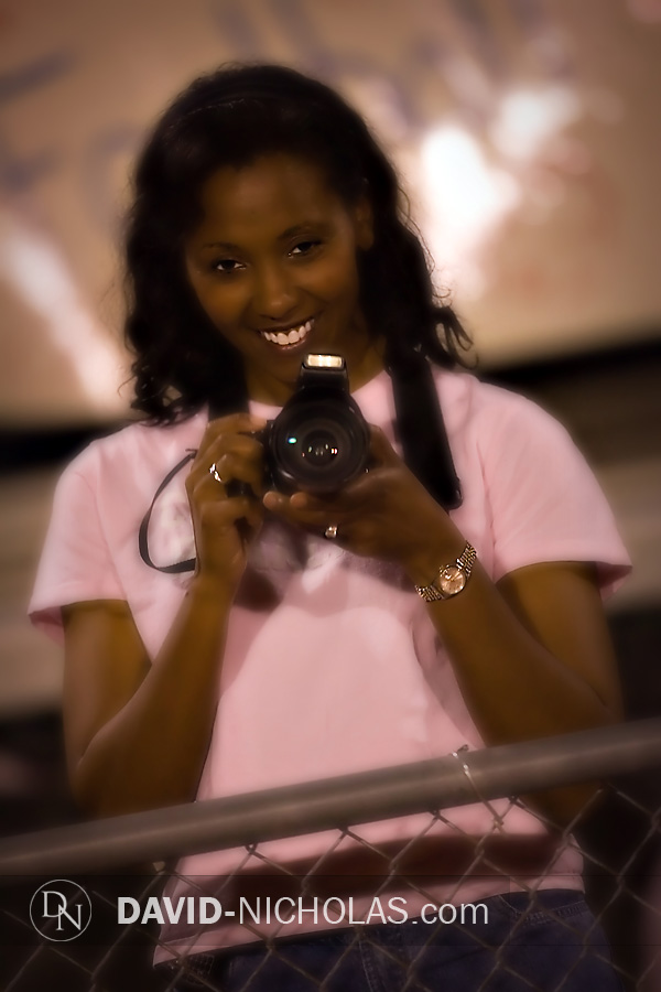 Pink was the color of the evening, as this proud Mom prepares to photograph her young daughter, one of many future C.B. East cheerleaders who cheered the first half of the game with the Varsity squad.