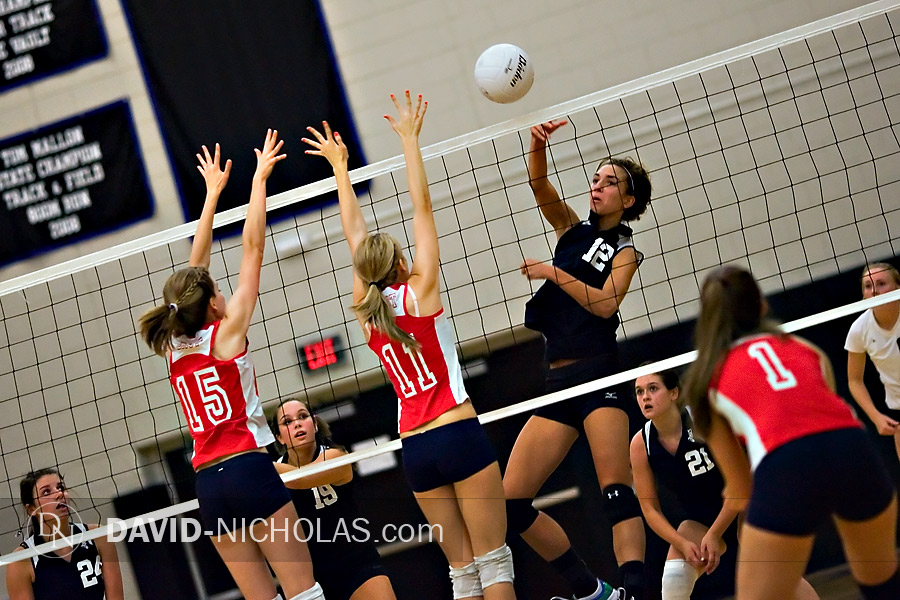 Lady Patriots Christine Gilbert (15) and Madi Staub (11) set up a double block in prepartion for a Lady Titans attack.
