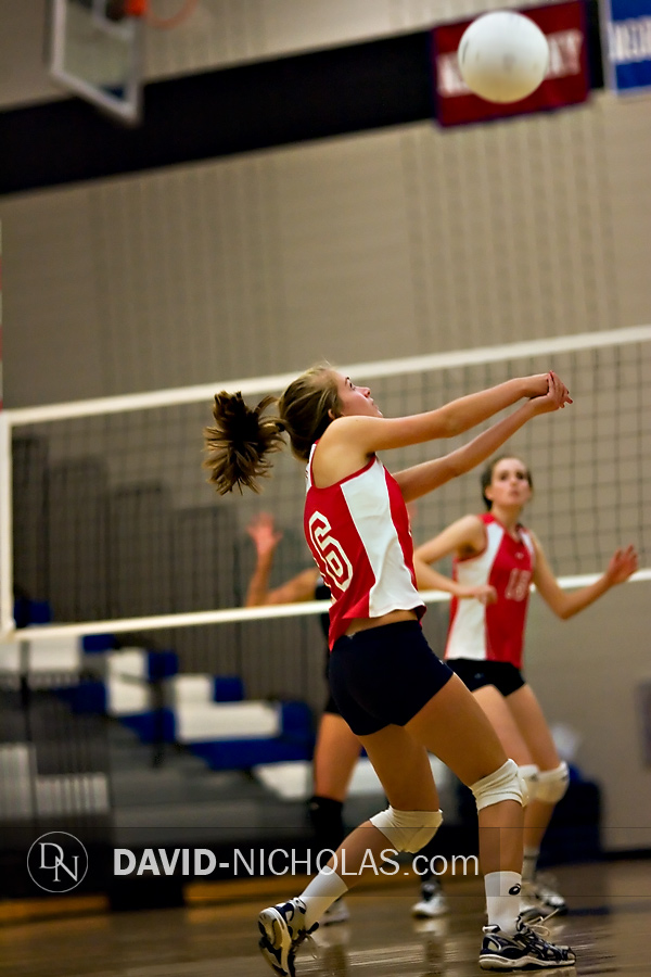 Lady Patriot Micaela Sheffield (16) passes the ball to her teammates at the net.