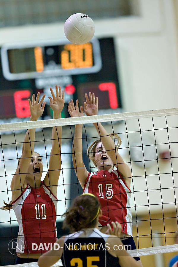 Lady Patriots Madi Staub (11) and Christine Gilbert (15) team up for a double block.