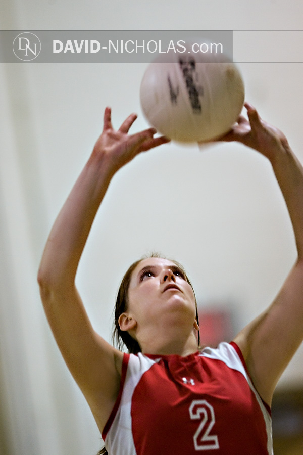 Lady Patriot Kelsi Halliwell (2) focuses on the ball for a precision set to fellow teammates at the net.