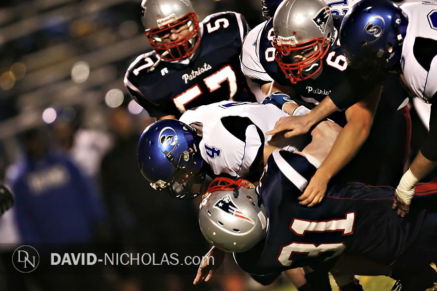 C.B. South's Chris Eberz (4) is halted by a sea of Patriot defenders including John Veix (31), Lance Rosina (66), and Zach Grillot (57).