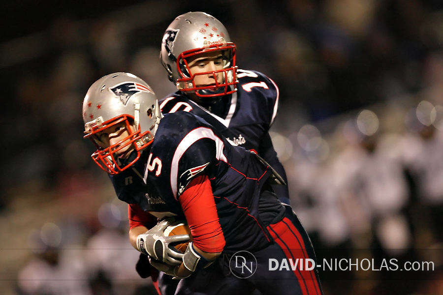 C.B. East's Josh Bernard (10) hands off the football to Conor Bednarzyk (5) during the final play of the game.