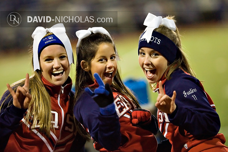 C.B. East cheerleaders Lauren, Casey and Justine enjoy a light moment in front of the camera in the 4th quarter.