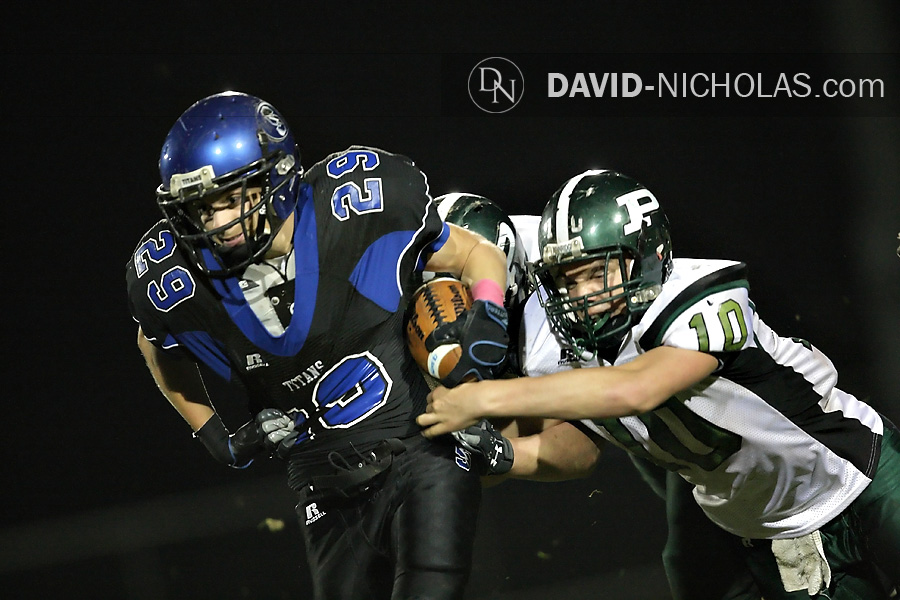 C.B. South's Joey Kenderdine (29) breaks through Pennridge defenders Brandon Cope (6) and Drew Smith (10) during a 3rd-quarter carry.