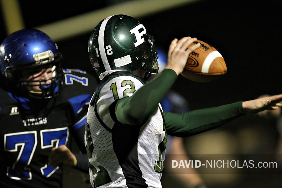 Pennridge's quarterback Kyle Peters (12) runs out of time as C.B. South defensive lineman Will Bendon (77) applies pressure.